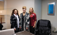 Lounge Makeover winner Mary Gregoski (center) enjoying Palmer School's new lounge with Jen Dubas from NSEA and California Casualty's Stephanie Whitmore
