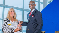 Kandy Moreau, chief lending officer at Infinity Federal Credit Union, accepts the Outstanding Community Partner award from ProsperityME executive director, Claude Rwaganje, on May 7, 2019.