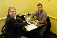 HHHunt SVP of Spring Arbor Senior Living Richard Williams and K4Connect CEO Scott Moody expand partnership over breakfast at the same restaurant table they did at the start of the relationship in 2017
