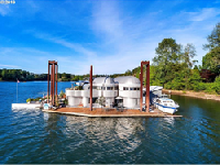 Iconic floating home in Portland, Oregon listed by Cascade Sotheby's International Realty.
