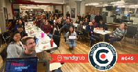 The Mindgrub Team celebrating the good news at a monthly all-hands meeting.