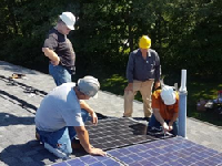 Attendees to the 2018 PVI1 workshop had a chance to put their newfound skills into action by expanding the existing array at the ETA headquarters.