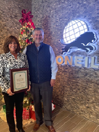 2019 Employee of the Year, Cindy Schneider pictured with ONEIL President and CEO, Hernan Olivas.