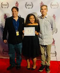 Angela Matemotja accepts 'Best Inspirational Feature' for ELEVATE at Golden State Film Festival - alongside festival Directors Jon Gursha and Peter Greene